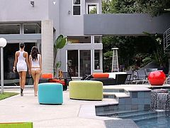 Brunette beauties Breanne Benson and April O'Neil get naughty by the pool before moving the fun inside and adding a hard cock to the party to fuck them both