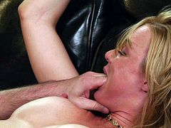 Captivating MILF in socks stimulated as her natural tits are sucked then gives a hot blowjob before being humped hardcore on a sofa