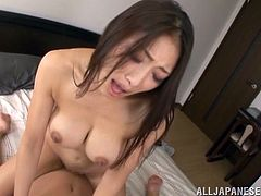 This dirty slut sucks on her man's cock to get him nice and hard and then she goes wild. The sexy brunette lady jumps on his cock and rides him fast while he fondles her perfect breasts. He plays with her nipples, and then she turns around to ride him reverse cowgirl style.
