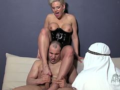 Horny mistresses are having a hardcore fuck in the couch and she called two of her arab slaves to assist and support them by licking and sucking her sexy toes.