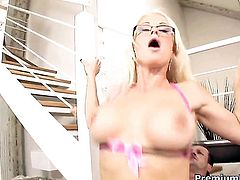 Stacy Silver with massive jugs shows her oral talents in blowjob action with hot dude