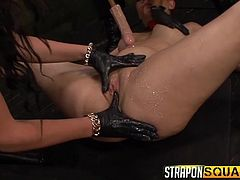 One bitch is laying on the floor helpless, as she is tied up strongly. Her legs and hands are in shackles. The other two ladies wear gloves and are fingering the slave's horny pussy, which is all wet, and appetizing. Click to watch the naughty sluts, playing dirty with sex toys, like a vibrator and a dildo. Enjoy!