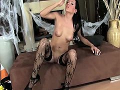 This little witch is not wicked, but she is super hot. She slowly exposes her boobies and pussy and rubs herself during the process. She only leaves her stockings on.
