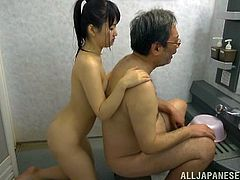This old pervert gets in the bathtub with this cute girl and she gives him a nice wash. She washes his body, to get him nice and clean, and he fingers her tight pussy. They kiss and get intimate in this naughty video.