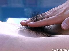 Voluptuous Japanese MILF having her hairy pussy shaved at the pool in close up shoot