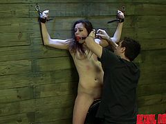 This slave is shackled tot he wall while she is made to sit on a sybian. She is enjoying the pussy insertion until her master comes along and chokes her fragile neck. He rams her from behind and makes her get on her knees to suck his cock
