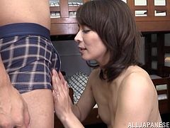 This sexy mature Japanese lady has her hairy bush fingered by her man. Once she is nice and wet she is ready to get down on her knees and suck on some cock. She licks the tip which makes his sensitive peehole drip precum out.