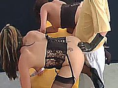 Two horny amateur ladies are simultaneously fisted in their gaping assholes by a perverted Dr