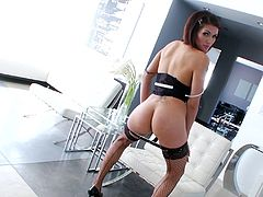 Pretty brunette shemale in lingerie, fishnet and high heels fingers and toy fucks her tight asshoke before jacking off her dick