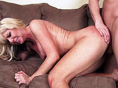 Big tits mom rides on a young prick