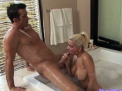 Bosomy blond haired MILF blows sweet cock of young stud in bath