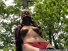 This girl has been very bad, so she is going to be brutally punished out in the woods, by her mean master. She is gagged and tied to a tree, like a whore. Her master is going to treat her, like a sex slave.