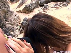 It looks, as if this Asian couple has found a piece of heaven in this wild rocky landscape. The horny guy and his sweet lover with small tits, wearing only a sexy swimsuit, enjoy some exciting moments. As the slut gets down, to suck his hard cock, the atmosphere becomes even hotter. See her banged from behind!