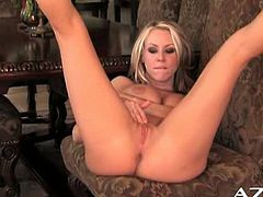 Carolyn Reese is playing with he big jugs and can't get enough. Her pussy is already dripping and she spreads legs to finger it for a nice orgasm!