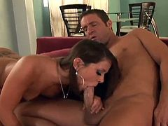Attractive brunette MILF strokes and slurps her raunchy lover's hard dick. She has her shaved pussy licked before being screwed long and hard.