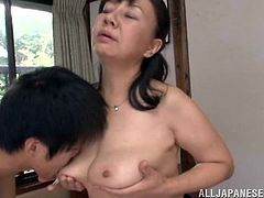Racy mature Asian cougar with big natural tits and long hair getting her tits fucked before getting smacked hardcore doggy style