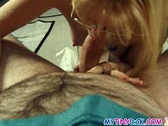 Blonde chick with glasses gives head over a tiny cock.See how this mature blonde milf gets on here knees for sucking on that small penis nicely and deeply.