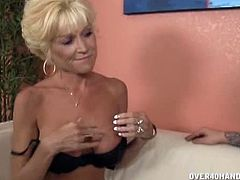Nikki Sixxx is a busty blonde mom who treats midget Mikey with a blowjob. He pinches her nipples while she strokes his dick and she also plays with her pussy.