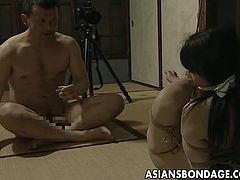 Tender Japanese hottie sits with her whole body bound. Her master licks her hairy wet pussy before banging her with a fucking machine and later on his stiff dong.
