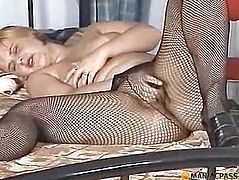 Lying on the bed fucks her pussy in pantyhose