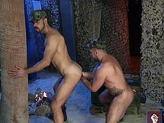 Dolan Wolf and Alessandro have been assigned the night watch at the compound. As soon as everyone is asleep the military studs strip out of their uniforms and get down to business. Both men stroke their big cocks while Dolan bends over and opens his furry hole to Alessandro's probing tongue. Once his hole is lubed and ready, Alessandro pulls on a black glove and begins his anal assault. Dolan proves to be quite a soldier, taking Alessandro's fist and half his forearm up his ass
