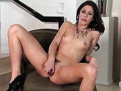 Anna Morna with tiny breasts and bald pussy touches her tits in a playful manner