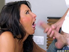 She heads up to the bedroom with this young guy and jacks him off so hard, and fast. The kinky pair gets caught in the act, by another of her son's friends and he wants to join in, too. Lezley sucks cock, while getting fucked from behind.
