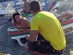 Sexy brunette slut gets pounded hard on the beach