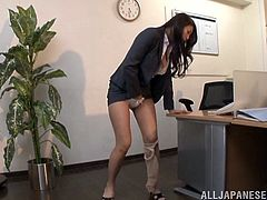 Solo model with long hair in nylon pantyhose fingering her pussy in the office