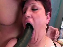 Lusty mature BBW with huge natural titties plays with big black stick in her mouth and pussy