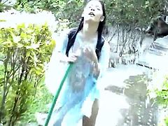 Sexy teen Thai Ivy is watering her plants but have something naughty in mind like getting her so wet showering her fresh luscious body especially her goodies.