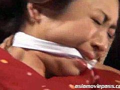 Asian slut tied up and tortured by sadistic master in this hot tube video.