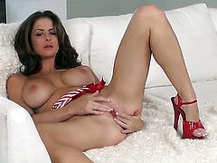 Emily Addison with massive hooters and hairless beaver having fun with dildo
