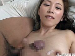 Smart Asian with long hair and natural tits in lingerie and stockings giving a blowjob before getting pounded hardcore doggy style