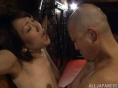 One of the cute female slaves is tied up in the sex dungeon and taunted by her master, as the mistress watching. The mistress is not pleased with the master's performance, so she ties him up instead. The two ladies suck the bound guy's cock and kiss him.