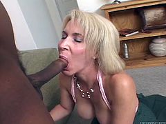 blonde granny gobbles down a white cock