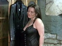 Mistress Candi teasing on her hot leather outfit