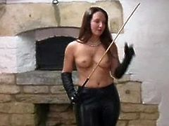 Sammi is a dominant female who loves the feeling of leather. She talks about her leather gloves while she is topless and while she is holding a whip in her hands.