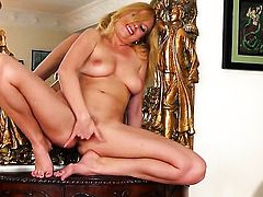 Carmen Gemini with big tits and smooth muff kills time playing with herself