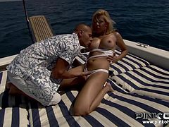 Under the sunny rays, a blonde bitch shows off her big, amazing tits and crazy ass. Victoria seduces the horny bald guy with a passionate kiss and her yummy appetizing breasts: so nice to squeeze and suck. Click to see the slutty babe helping the man to relax while she takes care of his cock.