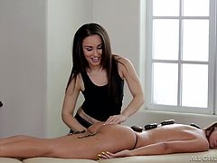 Jada gives the sexy and horny girl called Gabriella, a nice stone massage. The hot stones are placed on the hot woman's body and ass, which makes her feel relaxed and even hornier. What kind of sexy fun will these two lesbians have after the massage?