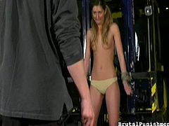 This naughty slave in heels is tied up by her master. She is in the sex dungeon and he is ready to give her some brutal punishment. He pulls on her pigtails, pinches her nipples, and humiliates her by pulling down her panties. What a bad girl she has been, and she needs to be punished.