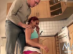 Naughty little redhead deepthroats her boyfriend´s cock before taking a hard pounding on the kitchen floor.