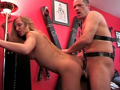 This dude's hands are tied but his nasty, pulsating cock shows that he enjoys being spanked by these lovely harlots.