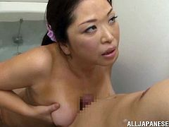 Bubbly Japanese milf delivers a tit job after a soapy bath