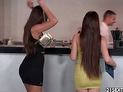 Two sexy club sluts blow the bartender