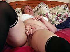 This lovely woman loves to have touch herself when she is alone. You would not find her sulking, when she can't find a man to fuck. Instead, she takes matters in her own hands. She lies down on the bed, puts her fingers inside her old pussy and makes sure she drills it as hard, as she can. Watch this sexy mature woman get the best out of her solo session.