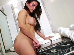 Curvy shemale with nice ass fingering her anal immensely in the bathroom