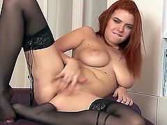 Redhead Marina Visconti  in black nylons shows off her massive tits as she finger fucks her shaved meaty pussy on camera. This naturally busty chick has a good time masturbating!