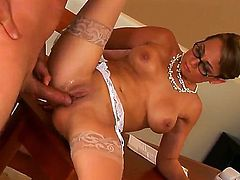 Four eyed slim MILF Holly West is a hot elegant woman in sheer stockings and black shoes. She gets her clean tight pussy fucked balls deep by her dangerously horny fuck buddy Dick Delaware.